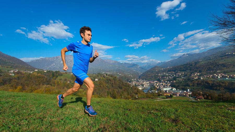 Full length of man running against sky