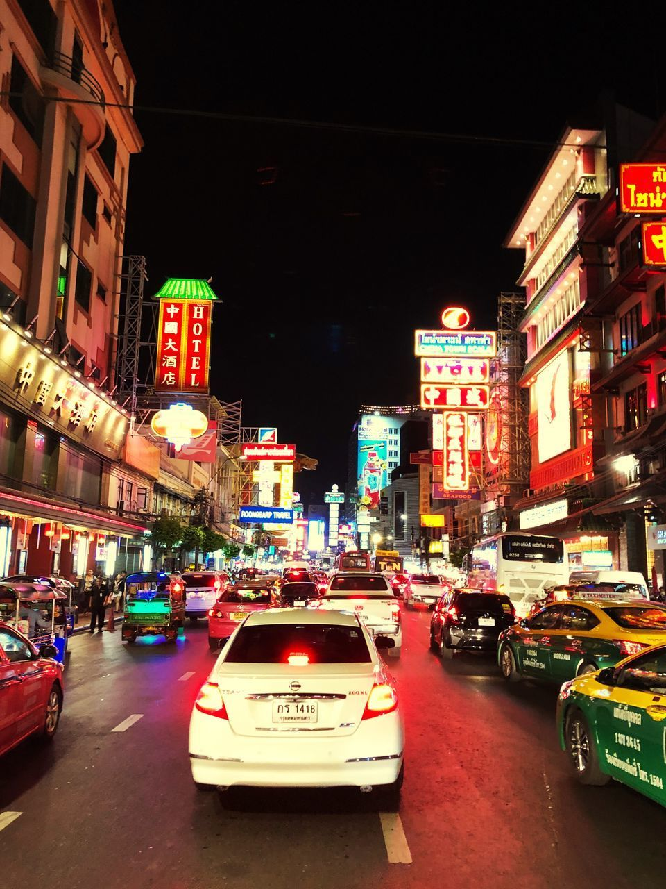 CARS ON CITY STREET AT NIGHT