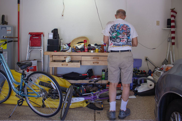 Bicycle Full Length Garage Messy Occupation One Person Rear View Reparing Standing