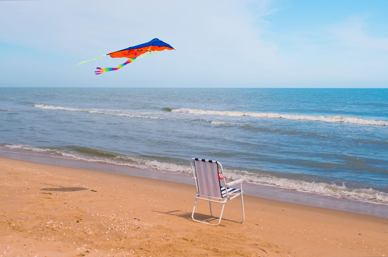 Beach Beach Day Beauty In Nature Holidays Idyllic Kite Kite Flying Message Non-urban Scene Ocean Outdoors Sand Sand & Sea Seashore Shore Summer Text Tourism Tranquil Scene Tranquility Travel Traveling Tropical Paradise Vacations Water