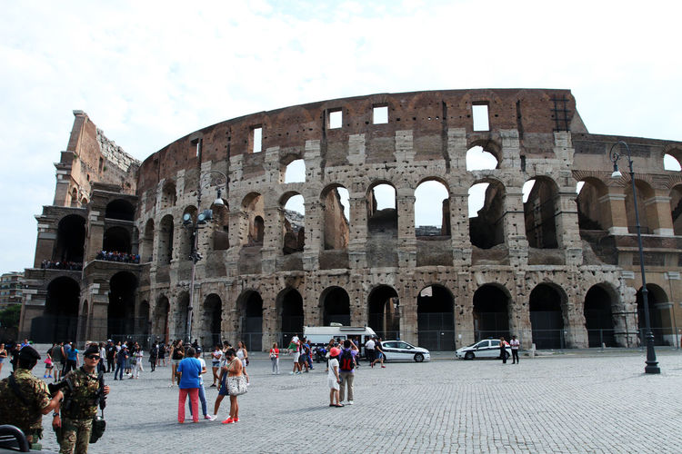 Adult Amphitheater Ancient Ancient Civilization Arch Archaeology Architecture Building Exterior Built Structure Colosseum Crowd Group Of People History Large Group Of People Old Ruin Outdoors Real People Ruined Sky The Past Tourism Tourist Travel Travel Destinations Visit Women