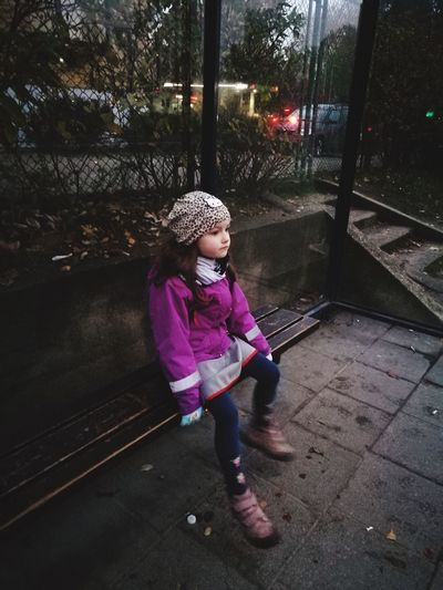 Full Length Childhood One Girl Only Girls Knit Hat Warm Clothing One Person Child People Day Outdoors Waiting Bus Stop