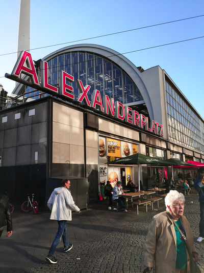 Huaweiphotography Alexanderplatz Adult Architecture Building Exterior Built Structure City Group Of People Lifestyles Old Woman Outdoors People Real People Sky Street Walking