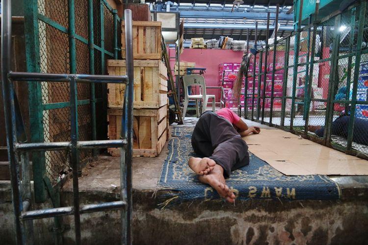 Man sleeping inside workshop