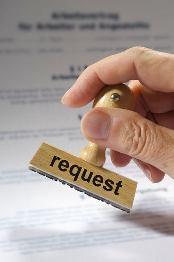 request printed on rubber stamp in hand Business Certified Regulate Rules Certification Compliance Contract Document Enquiry Guidelines Human Hand Inquiry Legal Licence On Demand Priority Query Question Regulations Request Requinbaleine rule of thirds Specification Stamp Text
