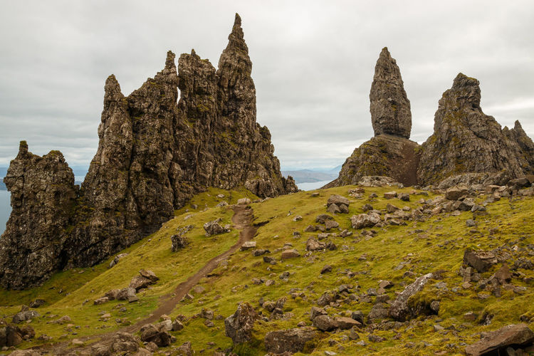 Scenic view of Old Man of Storr. - Isle of Skye, 2017 Sky Rock Rock - Object Solid No People Scenics - Nature Beauty In Nature Nature Tranquil Scene Tranquility Rock Formation Land Cloud - Sky Non-urban Scene Day Environment Outdoors Landscape Grass Formation Eroded Scotland Isle Of Skye Trotternish Old Man Of Storr Inner Hebrides Wilderness The Great Outdoors - 2019 EyeEm Awards