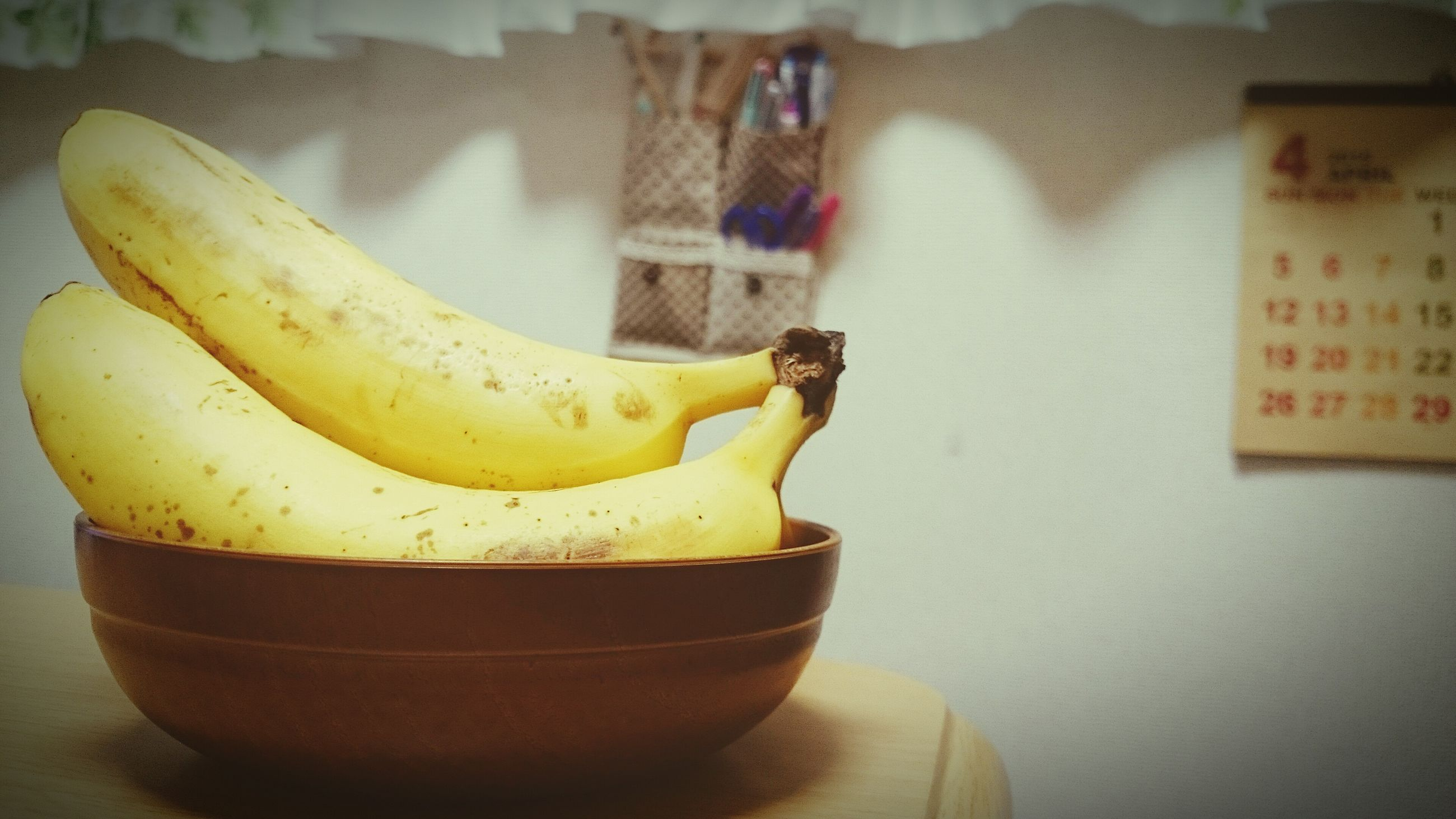 indoors, food and drink, freshness, food, still life, close-up, table, yellow, healthy eating, focus on foreground, fruit, text, no people, plate, banana, container, western script, selective focus, refreshment, home interior