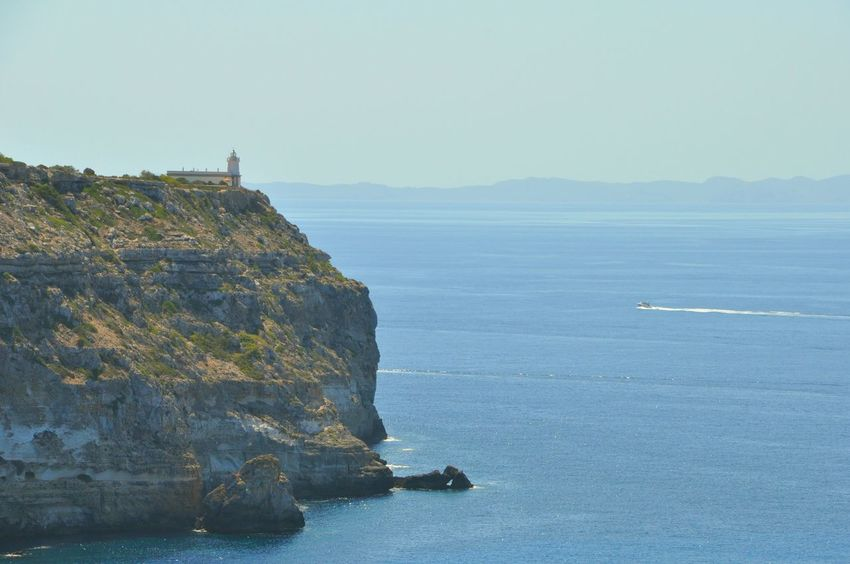 Lighthouse at the edge of a cliff in Mallorca ,Spain Lighthouse On A Cliff Lighthouse Cliffs SPAIN Simple Beauty Vacation Blue Water Cliff And Blue Sea Enjoying Life Travel Traveling Blue Ocean Mallorca A Bird's Eye View Coastline Landscape Landscapes Coast Line  High Cliff Coastline Hidden Gems  Cliffside Paradise Island Live The Moment  Blue Sea And Cliffs Picture Perfect