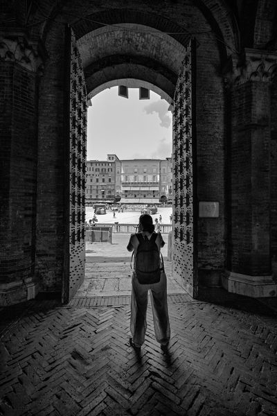 Ancient Arch Architecture Black & White Black And White Built Structure Day Door Full Length Gate History Medieval Medieval Architecture Medieval Town People Photgrapher Piazza Del Campo Rear View Shadow Silhouette