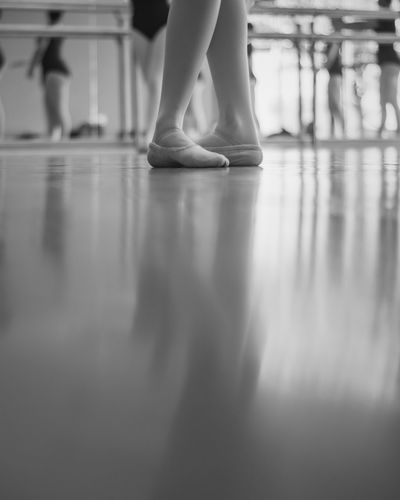 Balance Ballet Ballet Dancer Ballet Studio Childhood Day Exercising Flexibility Human Body Part Human Leg Indoors  Leisure Activity Lifestyles Low Section One Person People Practicing Real People Reflection Skill  Standing Women Young Adult