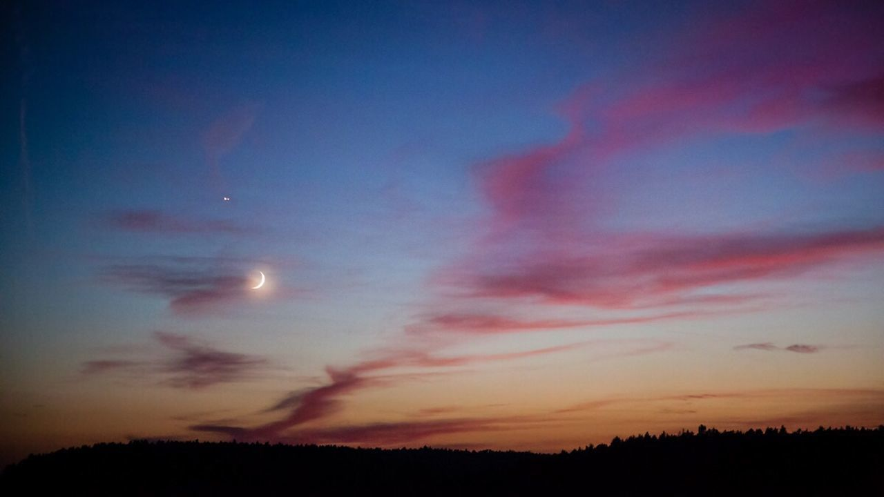Scenic View Of Crescent Moon During Sunset