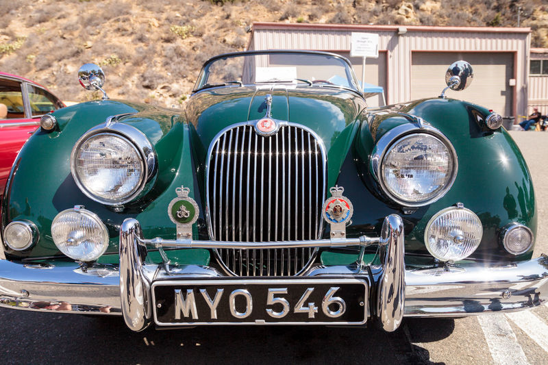 Laguna Beach, CA, USA - October 2, 2016: Green 1958 Jaguar XK 150 owned by Hathaway and displayed at the Rotary Club of Laguna Beach 2016 Classic Car Show. Editorial use. 1958 Automobile Car Show Classic Car Classic Car Show JAGUAR Jaguar XK Jaguar XK 150 Laguna Beach Old Old Car Old Cars Vintage Vintage Car Vintage Car Show Vintage Cars
