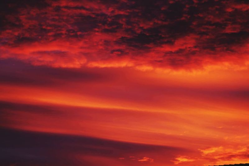 Cloud - Sky Sky Orange Color Beauty In Nature Sunset Dramatic Sky Scenics - Nature Tranquil Scene Low Angle View Nature Full Frame Space Outdoors Idyllic Backgrounds Tranquility No People Red Multi Colored Romantic Sky