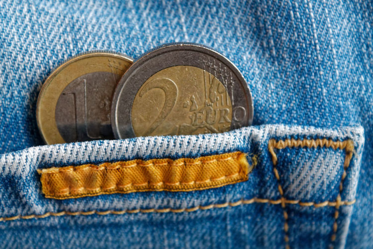 Close-up of coins in back pocket of jeans