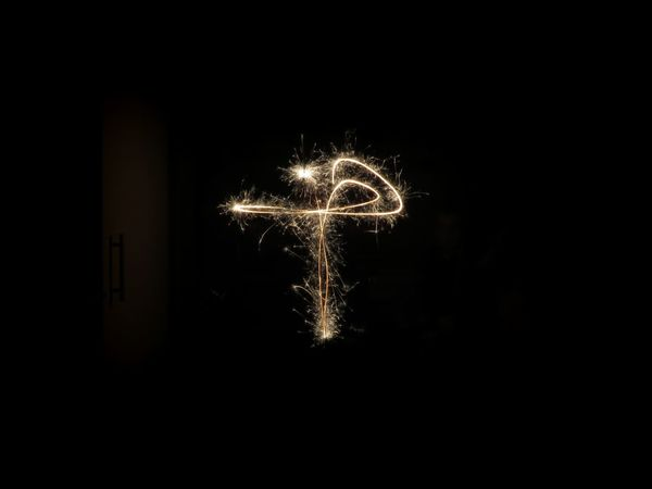 Sparkling cross, long exposure Cross Illuminated Black Background Sparkler Firework Display Celebration Firework - Man Made Object Long Exposure Communication Arts Culture And Entertainment Christmas Decoration Light Painting Sparks Glowing Burning