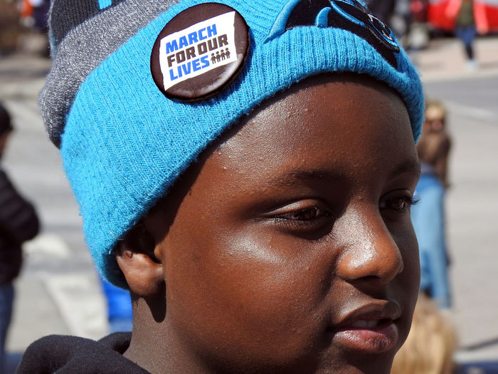 "A young boy waring a ""March for Our Lives"" button at the pro- gun control March For Our Lives in Washington, DC on March 24, 2018. Protest Activism Close-up Day Focus On Foreground Gun Control Gun Safety Headshot Incidental People March For Our Lives Mass Shooting One Person Outdoors Real People Young Adult"