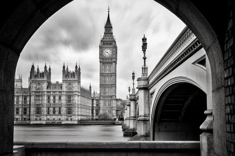 Big ben by thames river seen from arch