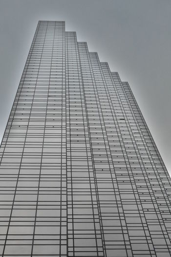 Low Angle View Architecture Built Structure Tall - High Building Building Exterior Sky Office Building Exterior Office Skyscraper No People City Tower Modern Day Clear Sky Nature Outdoors Glass - Material Pattern New York City