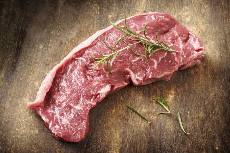 BBQ Beef Cooking Entrecote Loin Barbecue Board Directly Above Food Food And Drink Freshness Herb Ingredient Meat No People Pepper Preparing Food Raw Food Red Meat Rosemary Herb Rump Rustic Spice Steak Wooden