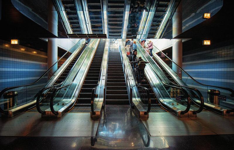 Escalator in illuminated building