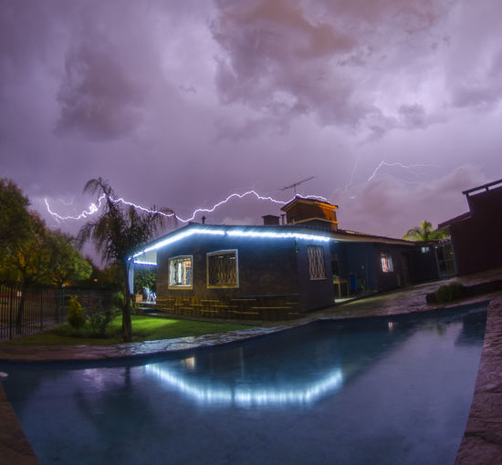 Architecture Building Building Exterior Built Structure City Cloud - Sky Illuminated Lightning Nature Night No People Ominous Outdoors Power In Nature Reflection Sky Storm Storm Cloud Swimming Pool Thunderstorm Water