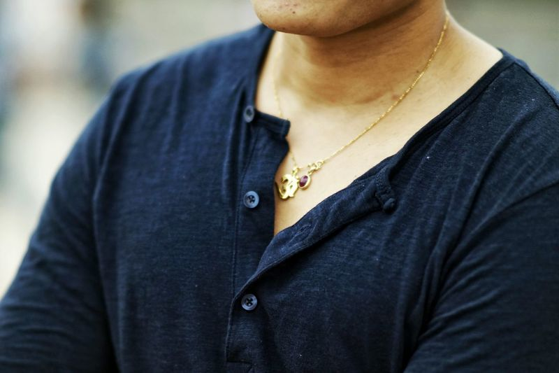 Midsection Of Man Wearing Gold Chain With Pendant