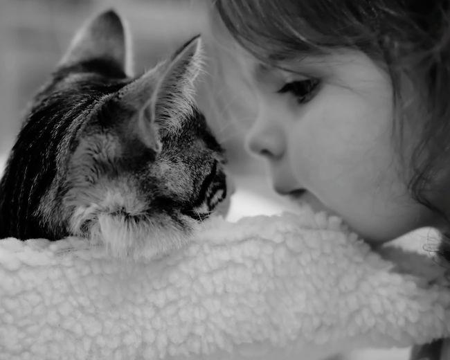 Loving each other Love Cat Lovers Daughter EyeEm Best Shots Malephotographerofthemonth Friendship Pets Child Dog Bonding Lying Down Eyes Closed  Childhood Embracing Love Pet Owner