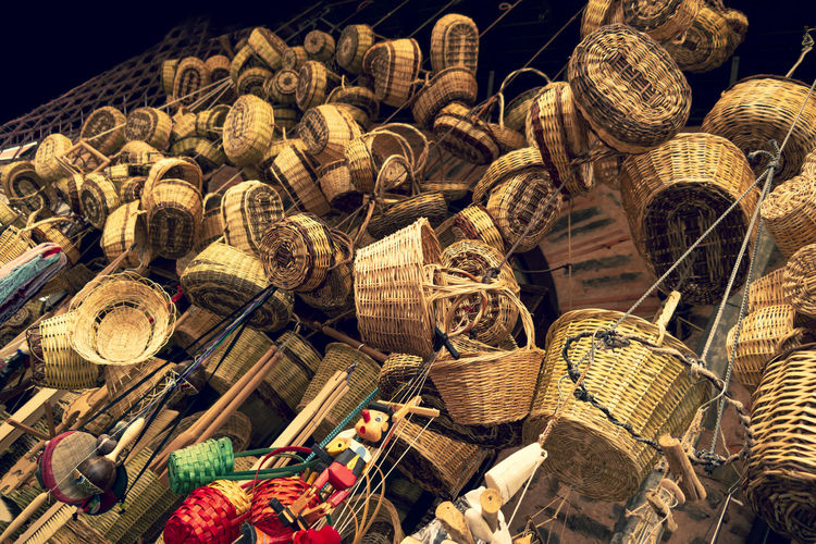 Low angle view of wicker objects for sale at market