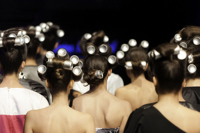 Tin cans used as a hairstyle modeling tool in hair of models on fashion show Rear View Group Of People Women Real People People Human Body Part Selective Focus Hair Group Adult Togetherness Tin Tincan Hairstyle Models Fashion Show Unique Concept Background Backdrop Design Element Modeling Tool Back View Creative Copy Space
