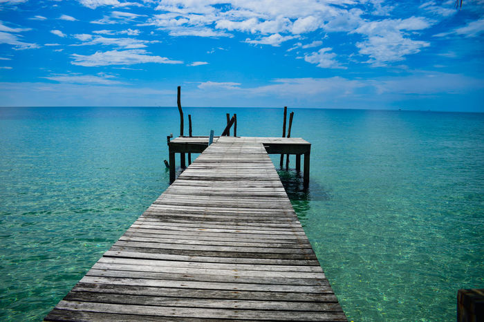 Bright Koh Kood Thailand Blue Blue Sky Cloud - Sky Day Fishing Pole Horizon Over Water Idyllic Jetty Leisure Activity Outdoors Paradise Pier Relaxation Sea Sea View Sky Summer Tranquil Scene Water Weekend Activities Wood Paneling