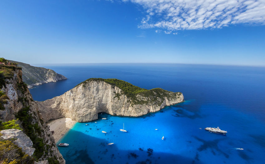 Beauty In Nature Blue Boats And Water Boats⛵️ Clear Sky Clear Sky Clear Water Greece Holiday Horizon Over Water Nature Navagio Outdoors Sand Sand & Sea Sea Sky Summer Tranquil Scene Turquoise Water Water Zakynthos