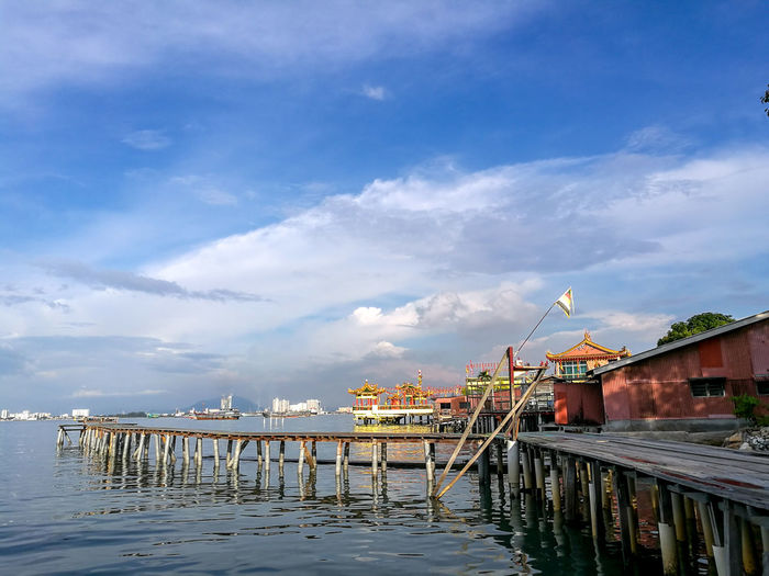 View from the Tan Jetty, Penang island, Malaysia. Streetphotography Architecture Bridge Building Building Exterior Built Structure Cloud - Sky Connection Day Nature No People Outdoors Pier Reflection River Sky Water Waterfront Wood - Material