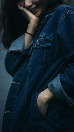 Midsection of woman in denim shirt