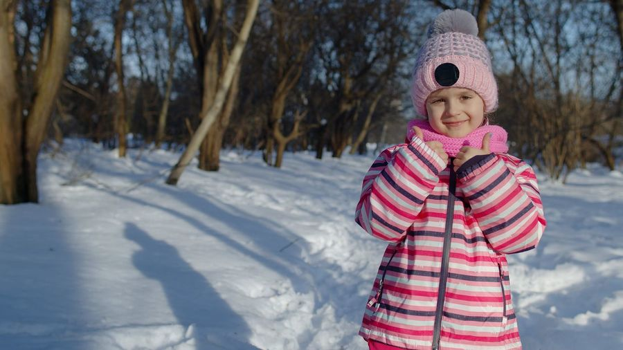 Full length of child standing on snow covered land