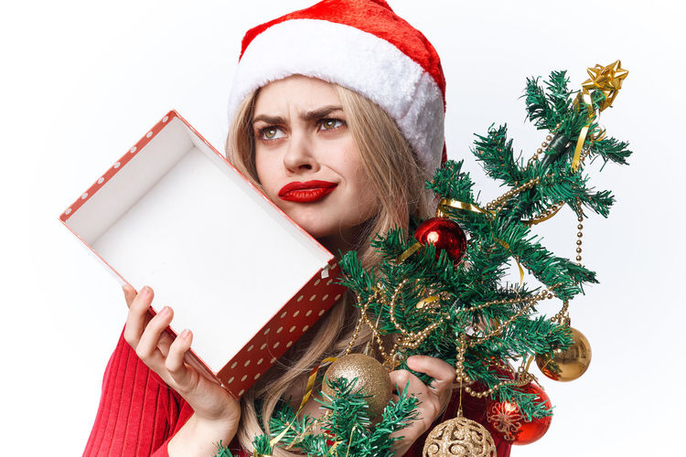 Midsection of woman holding christmas tree
