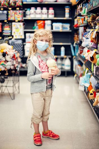 Full length of girl standing at store