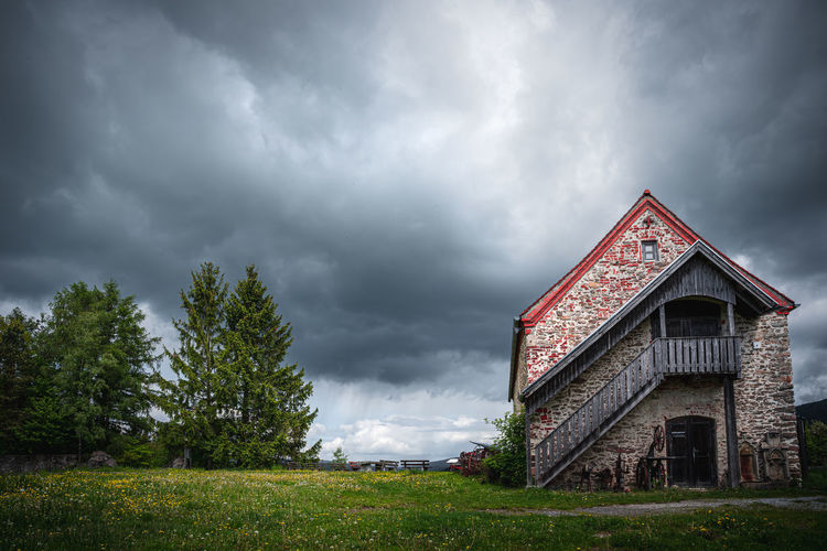 View of old building against cloudy sky