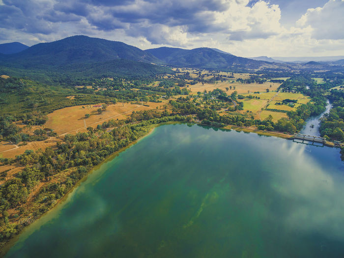 Beautiful aerial landscape of lake and river in Australian countryside on summer day Australia Australian Australian Landscape Drone  Nature Scenic View Aerial Aerial View Beauty In Nature Cloud - Sky Dam Day Drone Photography Eildon Idyllic Lake Lake Eildon Landscape Mountain Mountain Range Nature No People Outdoors Park Scenics Sky Tranquil Scene Tranquility Water