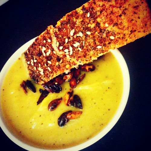 Pumpkin soup topped with roasted pumpkin seeds and a side of a home baked piri piri bread . Comfort food at its best :D Bbboys Lunchwiththebros Yummmm  Breadlove