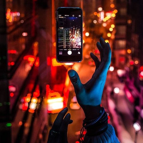 Flying High Wireless Technology Communication Night Mobile Phone Portable Information Device Smart Phone Technology Photo Messaging Illuminated Travel Human Body Part Adults Only People Men Indoors  Adult Human Hand Touch Screen Internet Connection