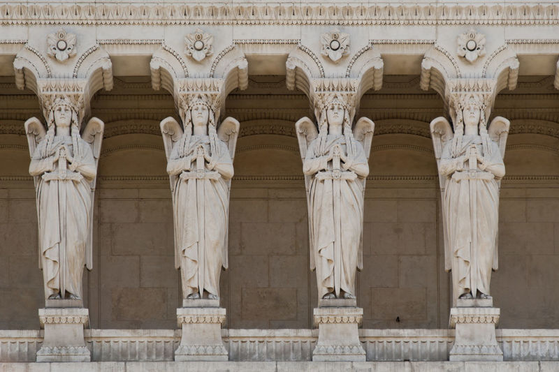 telamons in shape of angels on the facade of notre dame de fourviere Lyon Rhône-Alpes Rhône Unesco World Heritage France Notre Dame De Fourviere Basilica Church Statue Angel Sculpture Religion Christian Marble Winged Figure Telamon