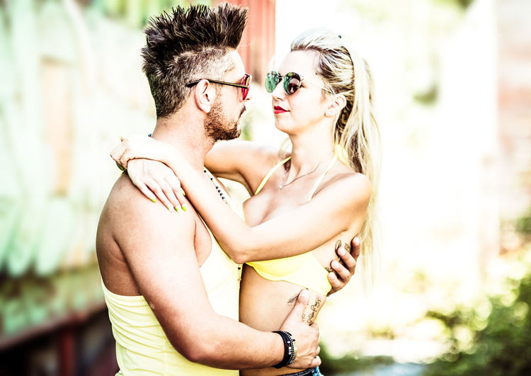 Togetherness Love Two People Young Adult Emotion Positive Emotion Couple - Relationship Young Men Women Bonding Young Women Real People Heterosexual Couple Adult Men Embracing Shirtless Day Focus On Foreground Hair Hairstyle Outdoors Arm Around