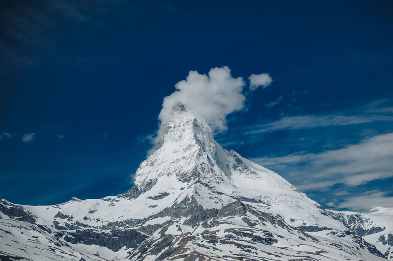 On the way from Matterhorn to Zermatt town. Beauty In Nature Cloud - Sky Cold Temperature Mountain Mountain Peak No People Power In Nature Scenics - Nature Sky Snow Snowcapped Mountain Tranquil Scene Tranquility White Color Winter