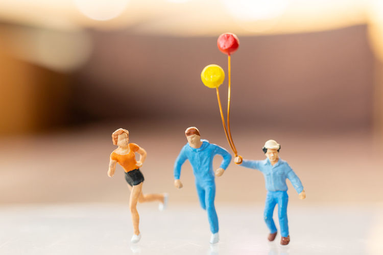 Rear view of people with balloons