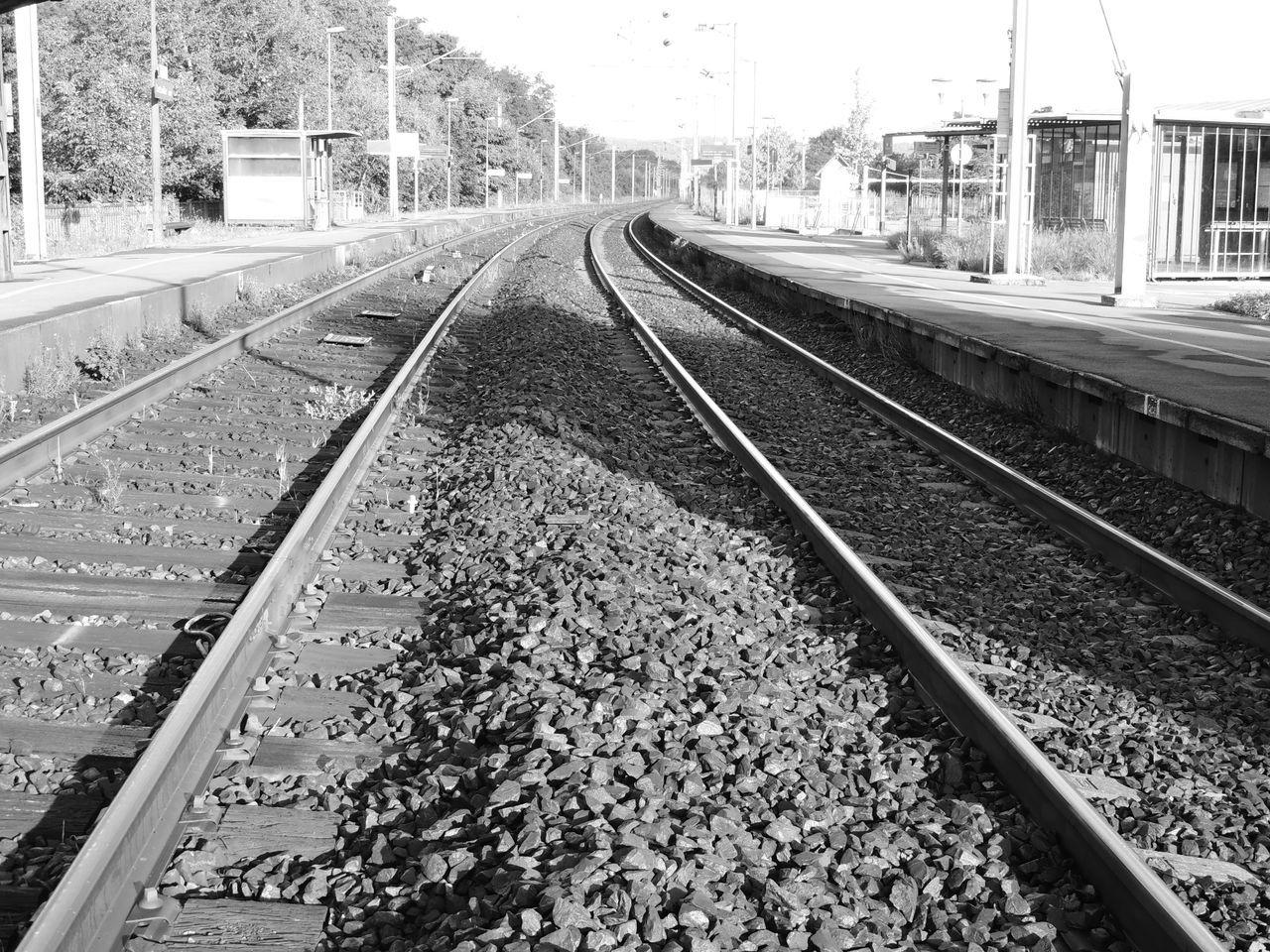railroad track, transportation, rail transportation, day, railroad tie, public transportation, railway track, outdoors, no people