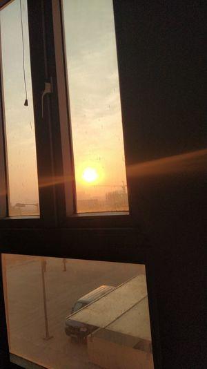 Sunset seen through glass window