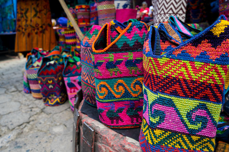 Chichicastenango Chichicastenango Market Scene Chichicastenango, Guatemala Guatemala Market Bag Choice Close-up Colorful Day Focus On Foreground For Sale Guate Large Group Of Objects Market Market Stall Multi Colored No People Outdoors Retail  Variation