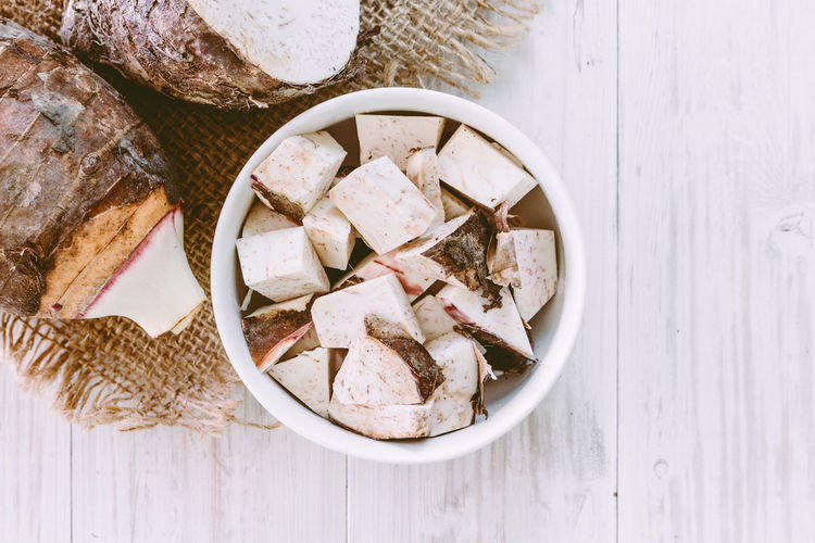 Taro root on wooden background Bowl Bread Breakfast Close-up Container Directly Above Food Food And Drink Freshness Healthy Eating High Angle View Indoors  Meal No People Ready-to-eat Serving Size SLICE Still Life Table Taro Root Wellbeing Wood - Material