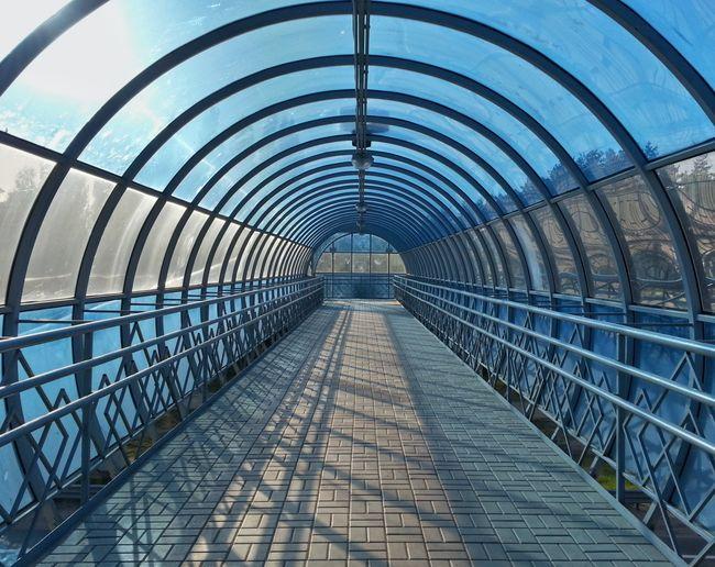 Low angle view of empty footbridge