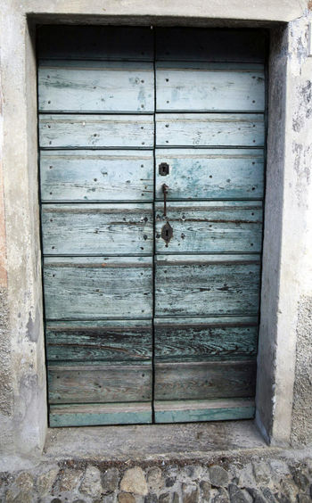 Closed wooden door of old building